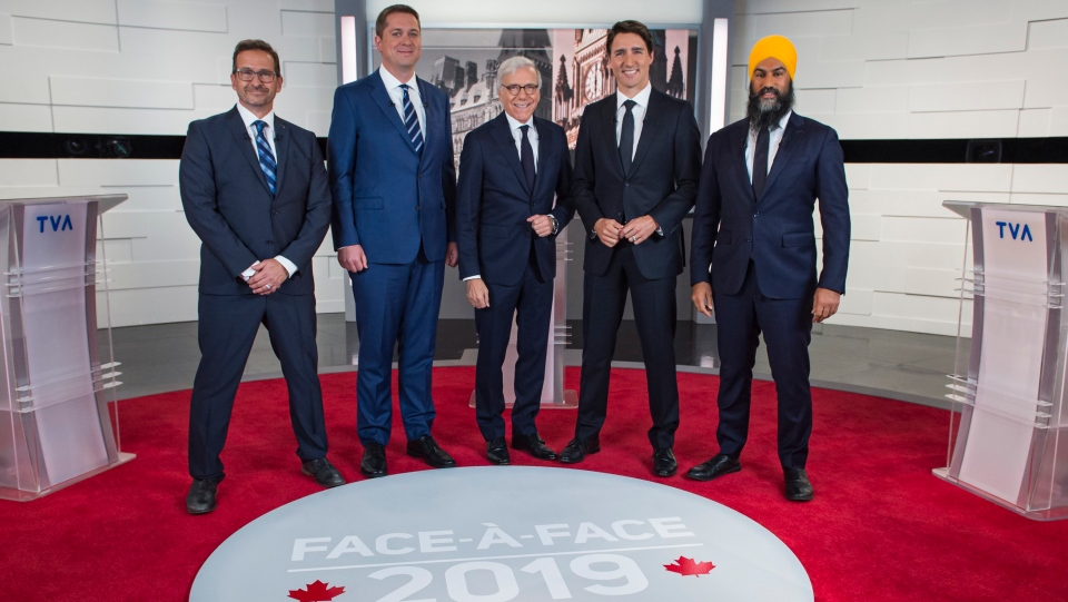 Leader of the Bloc Quebecois Yves-Francois Blanchet, left to right, Conservative Leader Andrew Scheer, TVA host Pierre Bruneau, Liberal Leader Justin Trudeau and NDP Leader Jagmeet Singh pose for a photo at the TVA french debate for the 2019 federal election, in Montreal, Wednesday, Oct. 2, 2019. THE CANADIAN PRESS/Joel Lemay, POOL