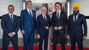 Leader of the Bloc Quebecois Yves-Francois Blanchet, left to right, Conservative Leader Andrew Scheer, TVA host Pierre Bruneau, Liberal Leader Justin Trudeau and NDP Leader Jagmeet Singh pose for a photo at the TVA french debate for the 2019 federal election, in Montreal, Wednesday, Oct. 2, 2019. THE CANADIAN PRESS/Joel Lemay