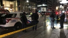Police are seen outside the entrance to St. Andrew Station on Oct. 3, 2019 after a fatal stabbing. (Mike Nguyen/CP24)