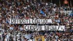 "In this Oct. 1, 2017 file photo, Lazio fans display a banner reading in Italian ""Banned fans with us, vile cops"" during a Serie A soccer match between Sassuolo and Lazio at the Olympic stadium in Rome. Lazio fans have a long history of racism and anti-Semitism but the Roman club's supporters established a new low on Sunday, Oct. 22, 2017 when they littered the Stadio Olimpico with superimposed images of Anne Frank - the young diarist who died in the Holocaust - wearing a Roma jersey. (Angelo Carconi/ANSA via AP, files)"