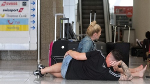 British passengers wait for news on cancelled Thomas Cook flights at Palma de Mallorca airport on Sept. 23, 2019. (Francisco Ubilla / AP)