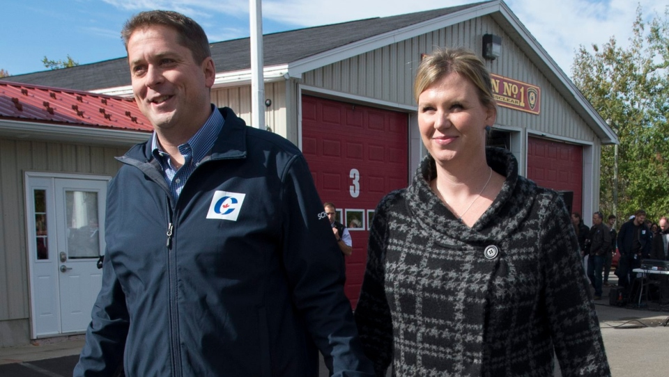 Conservative leader Andrew Scheer and his wife Jill are seen following the morning announcement at a volunteer fire department in Upper Kingsclear, N.B. Thursday, October 3, 2019. THE CANADIAN PRESS/Jonathan Hayward