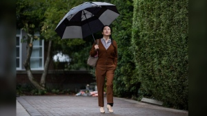 Huawei chief financial officer Meng Wanzhou, who is out on bail and remains under partial house arrest after she was detained last year at the behest of American authorities, carries an umbrella to shield herself from rain as she leaves her home to attend a court hearing, in Vancouver, on Thursday October 3, 2019. THE CANADIAN PRESS/Darryl Dyck