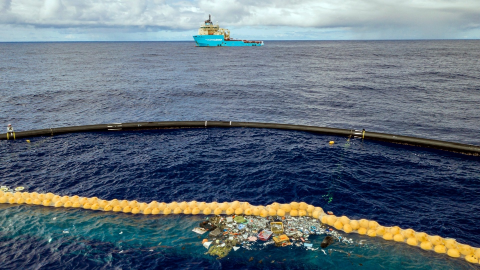 In this undated handout photo provided by The Ocean Clean Up, plastic is retained in front of an extended cork line in the Pacific Ocean. (The Ocean Cleanup via AP)