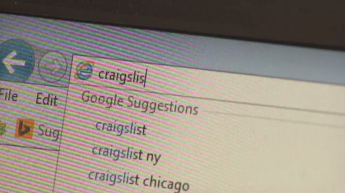 Someone typing Craigslist into a search bar