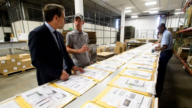 Chief Electoral Officer Stephane Perrault tours Elections Canada's distribution centre as workers prepare shipments in Ottawa on Thursday, Aug 29, 2019. THE CANADIAN PRESS/Sean Kilpatrick