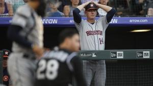 Houston Astros manager AJ Hinch, back, in Denver on July 2, 2019. (David Zalubowski / AP)