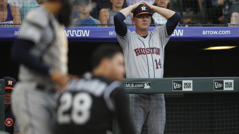 Houston Astros manager AJ Hinch, back, in Denver on July 2, 2019. (David Zalubowski / AP)