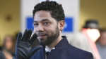 Jussie Smollett smiles and waves to supporters before leaving Cook County Court after his charges were dropped, in Chicago, on March 26, 2019. (Paul Beaty / AP)