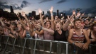 Concertgoers at the Lollapalooza Festival in Chicago, on Aug. 3, 2013. (Scott Eisen / THE CANADIAN PRESS / AP)