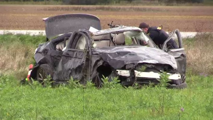 An OPP officer works at the scene of a crash that left three people dead in Oil Springs, Ont. on Friday, Oct. 4, 2019. (Gerry Dewan / CTV London)