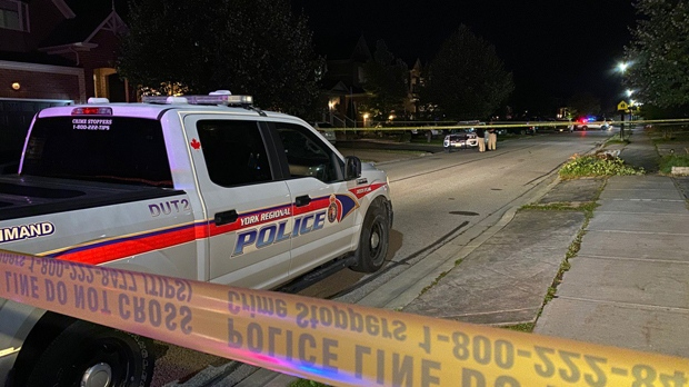 Police vehicles are seen on Coulter Street in Newmarket after a shooting that left a male dead on Oct. 4, 2019. (John Hanley)
