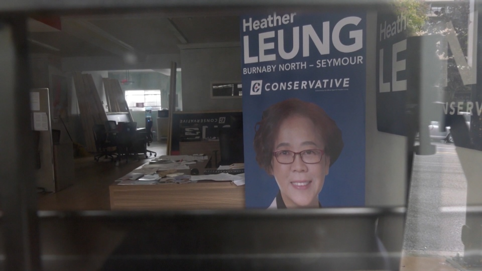 Signs can be seen inside Heather Leung's Burnaby North-Seymour campaign office Friday. (CTV)