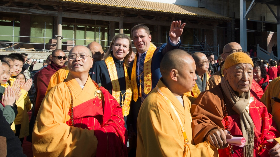 Conservative Leader Andrew Scheer and his wife Jill attends the opening of a Buddhist Temple in Bethany, Ont., on Saturday, October 5, 2019. THE CANADIAN PRESS/Jonathan Hayward