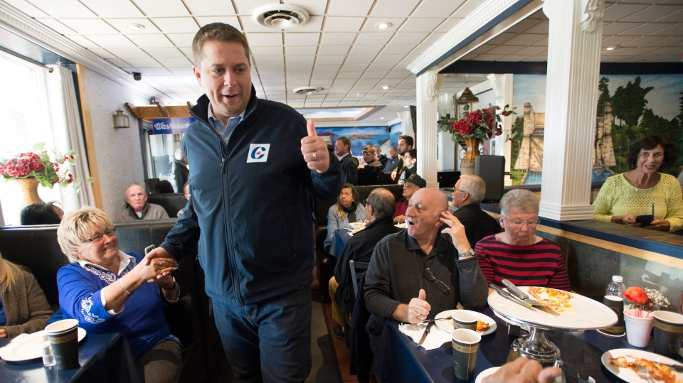 Conservative Leader Andrew Scheer greets patrons at a pizza restaurant in Peterborough, Ont., on Saturday, October 5, 2019. THE CANADIAN PRESS/Jonathan Hayward