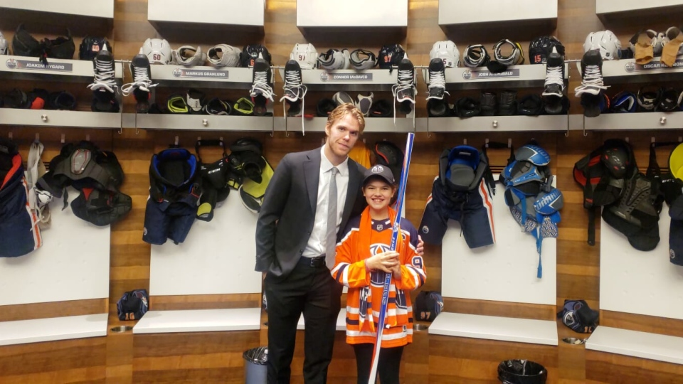 Connor McDavid meeting fan Taylor Friedel after the Oilers game. Oct 5, 2019. (Rod Oracheski)