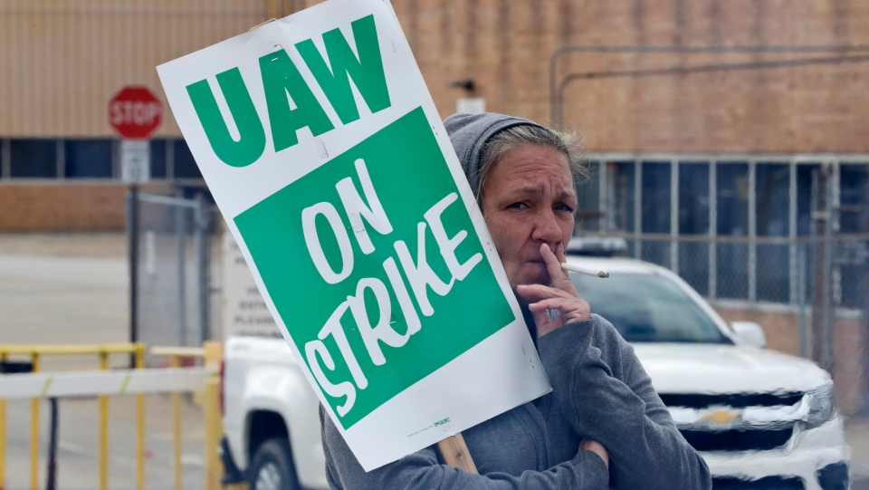 Cynthia Kauslick, a 20-year employee, pickets outside the General Motors Fabrication Division, Friday, Oct. 4, 2019, in Parma, Ohio. (AP Photo/Tony Dejak)