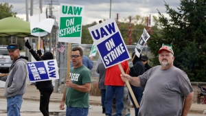 John Kirk, right, a 20-year employee, pickets with co-workers outside the General Motors Fabrication Division, Friday, Oct. 4, 2019, in Parma, Ohio. (AP Photo/Tony Dejak)