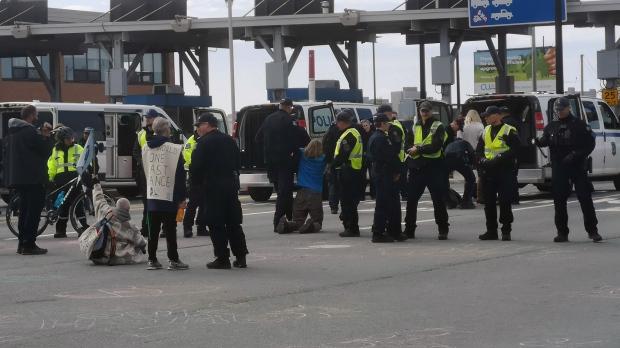 Halifax police arrest 18 Extinction Rebellion protesters at Macdonald Bridge - CTV News