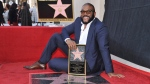 "Filmmaker/actor Tyler Perry, known for the ""Madea"" films, poses atop his star on the Hollywood Walk of Fame on Tuesday, Oct. 1, 2019, following a ceremony in Los Angeles. (Photo by Richard Shotwell/Invision/AP)"