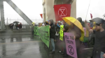 Climate protesters on the Burrard Street Bridge on Oct. 7, 2019 as part of a rally organized by Extinction Rebellion.