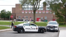 Police investigate after a 14-year-old boy was killed in an assault outside Sir Winston Churchill Secondary School. (Ricardo Alfonso/CTV News Toronto)