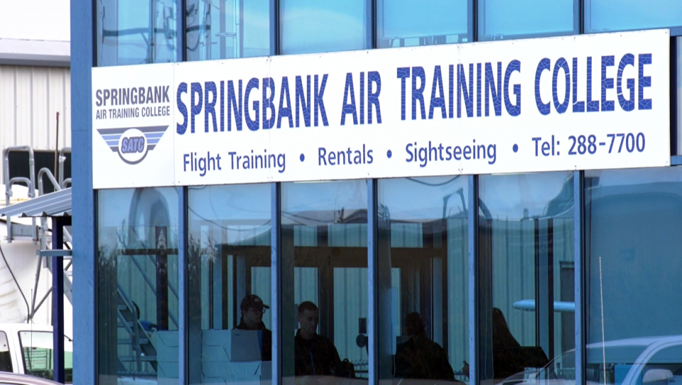 A lawsuit has been filed by three former students against Springbank Air Training College and WestJet
