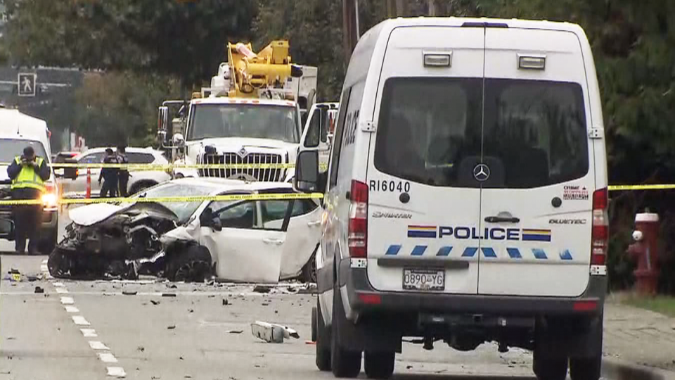 A damaged vehicle is seen at the site of what the RCMP called a