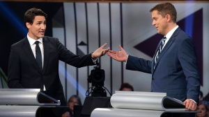 Conservative leader Andrew Scheer, right, and Liberal leader Justin Trudeau gesture to each other as they both respond during the Federal leaders debate in Gatineau, Que. on Monday, October 7, 2019. THE CANADIAN PRESS/Justin Tang