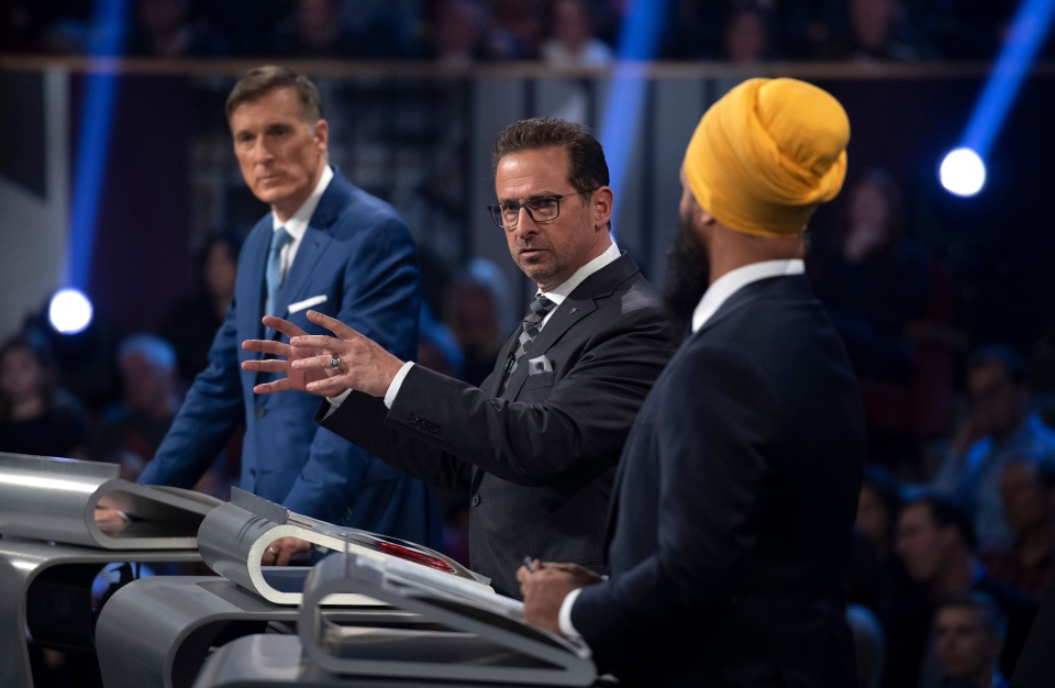 People's Party of Canada leader Maxime Bernier, left, and NDP leader Jagmeet Singh, right, look on as Bloc Quebecois leader Yves-Francois Blanchet speaks during the Federal leaders debate in Gatineau, Que. on Monday, October 7, 2019. THE CANADIAN PRESS/Justin Tang