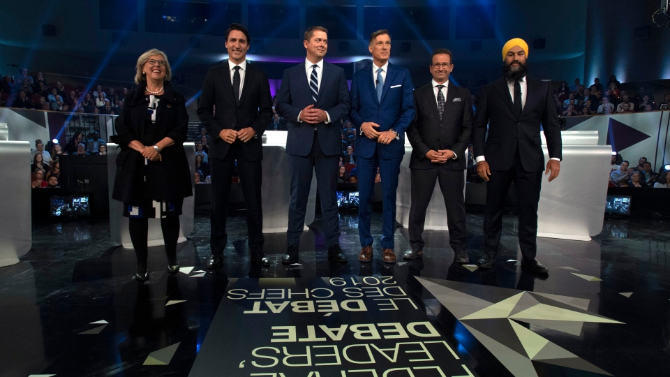 Federal party leaders Green Party leader Elizabeth May, Liberal leader Justin Trudeau, Conservative leader Andrew Scheer, People's Party of Canada leader Maxime Bernier, Bloc Quebecois leader Yves-Francois Blanchet and NDP leader Jagmeet Singh pose for a photograph before the Federal leaders debate in Gatineau, Que. on Monday, October 7, 2019. THE CANADIAN PRESS/Justin Tang