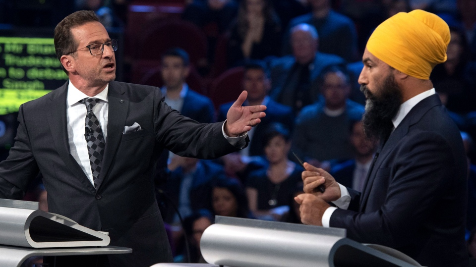 Bloc Quebecois leader Yves-Francois Blanchet and NDP leader Jagmeet Singh debate a point during the Federal leaders debate in Gatineau, Que. on Monday, October 7, 2019. THE CANADIAN PRESS/Justin Tang