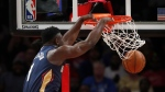 New Orleans Pelicans forward Zion Williamson (1) scores during the first half of a preseason NBA basketball game against the Atlanta Hawks, Monday, Oct. 7, 2019, in Atlanta. (AP Photo/John Bazemore)