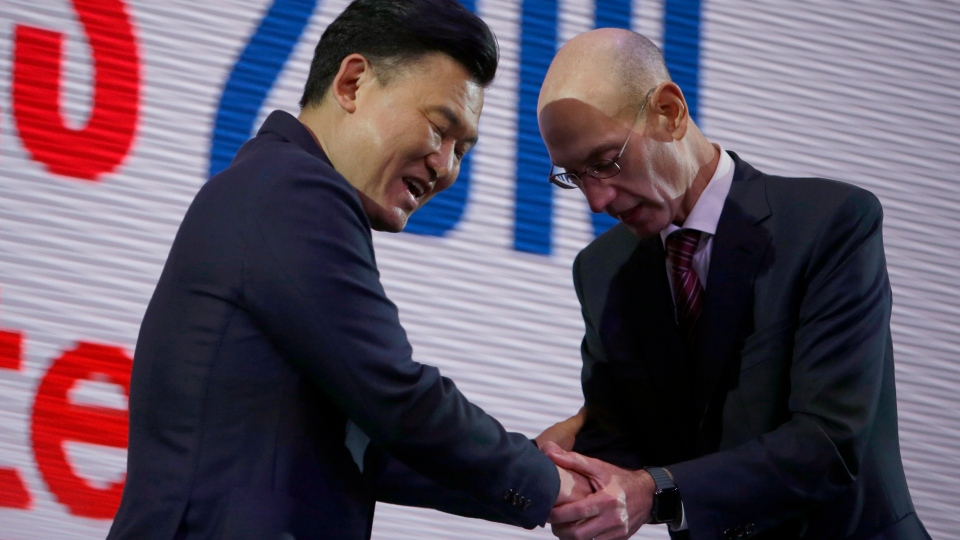 NBA Commissioner Adam Silver, right, and Rakuten, Inc. Chairman & CEO Mickey Mikitani greet each other during a welcome reception for the NBA Japan Games 2019 between the Toronto Raptors and the Houston Rockets in Tokyo, Japan, Monday, Oct. 7, 2019. (AP Photo/Kiichiro Sato)
