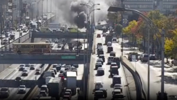 Dump truck on fire causes major traffic headaches on Decarie Expressway