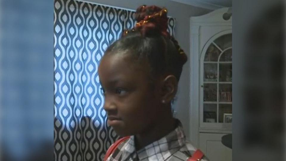 The parents of an 8-year-old Michigan student are speaking out after their daughter was denied a school photo for wearing red extensions in her hair.