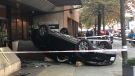 A black sedan ended up flipped on the sidewalk in downtown Vancouver on Oct. 8, 2019.