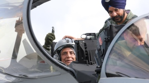 Indian Defense Minister Rajnath Singh thumbs up as he sits in a Rafale jet fighter during an handover ceremony at the Dassault Aviation plant in Merignac, near Bordeaux, southwestern France, Tuesday, Oct. 8, 2019. France has delivered to India its first Rafale fighter jet from a series of 36 aircraft purchased in a multi-billion dollar deal in 2016. (AP Photo/Bob Edme)