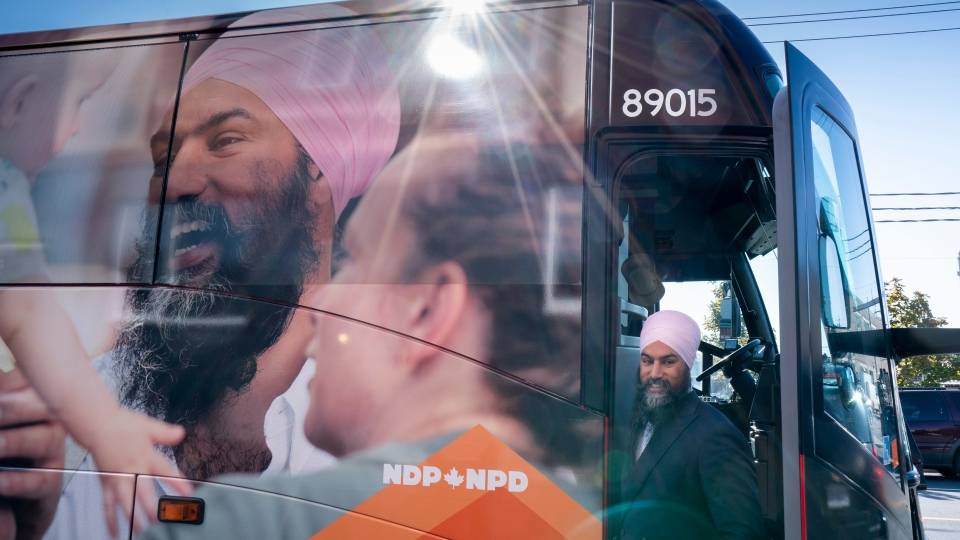 NDP Leader Jagmeet Singh steps off his campaign bus in Toronto on Tuesday, October 8, 2019. THE CANADIAN PRESS/Paul Chiasson