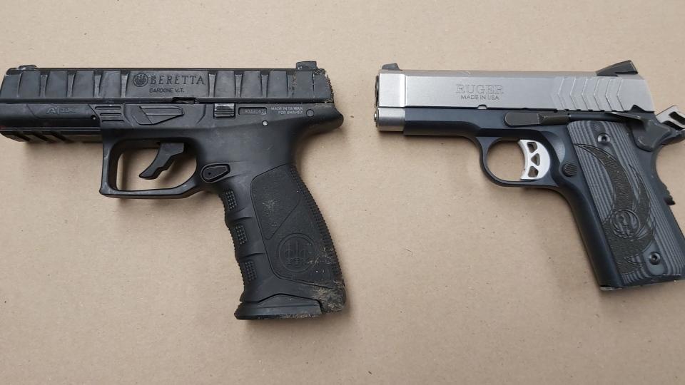 A gun and a replica gun