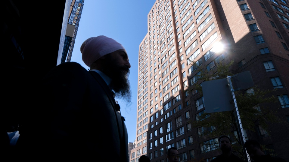 NDP Leader Jagmeet Singh walks the streets of downtown Toronto, on Oct. 8, 2019. THE CANADIAN PRESS/Paul Chiasson