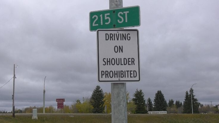 Frustrated drivers on 215 St. and Stony Plain Rd. give warning sign cold shoulder