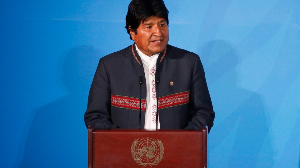Bolivia's President Evo Morales addresses the Climate Action Summit in the United Nations General Assembly at the U.N. headquarters, Monday, Sept. 23, 2019. (AP Photo/Jason DeCrow)