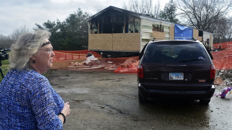 FILE - In this Sunday, April 7, 2019, file photo, Marie Chockley, a resident of the Timberline Trailer Court, north of Goodfield, Ill., surveys the damage that was caused by a Saturday night fire that killed five residents in a mobile home. (Kevin Barlow/The Pantagraph via AP, File)