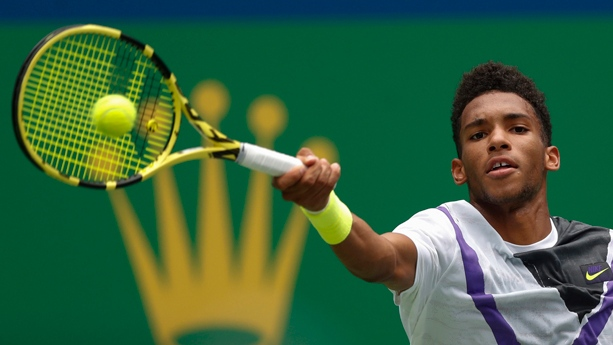 Felix Auger-Aliassime of Canada hits a return against Stefanos Tsitsipas of Greece during the men's singles match at the Shanghai Masters tennis tournament at Qizhong Forest Sports City Tennis Center in Shanghai, China, Wednesday, Oct. 9, 2019. (AP Photo/Andy Wong)