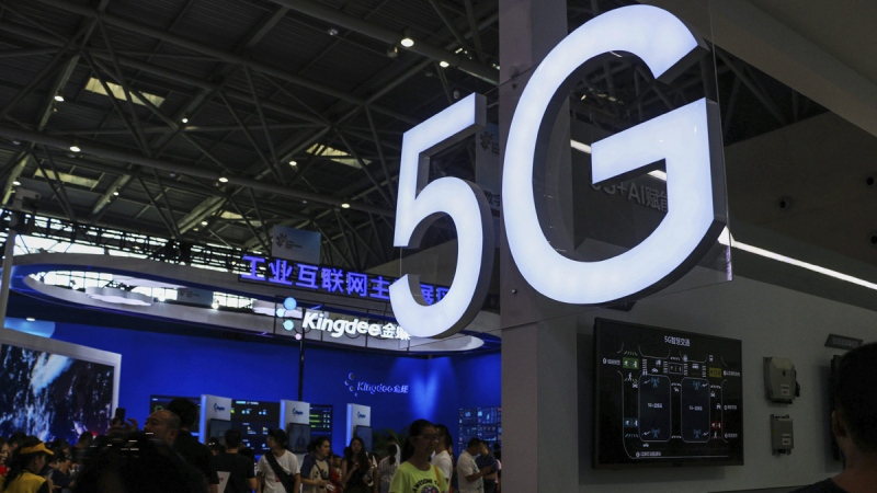 An exhibitor booth with a 5G on display at the Smart China Expo, on Aug. 27, 2019. (Chinatopix via AP)