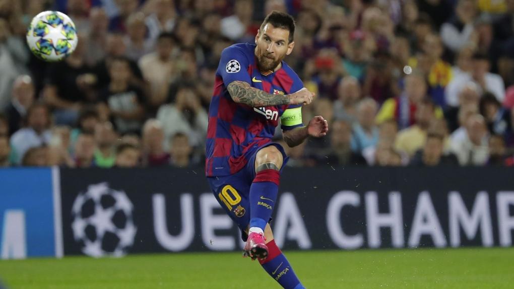 Barcelona's Lionel Messi makes a free kick