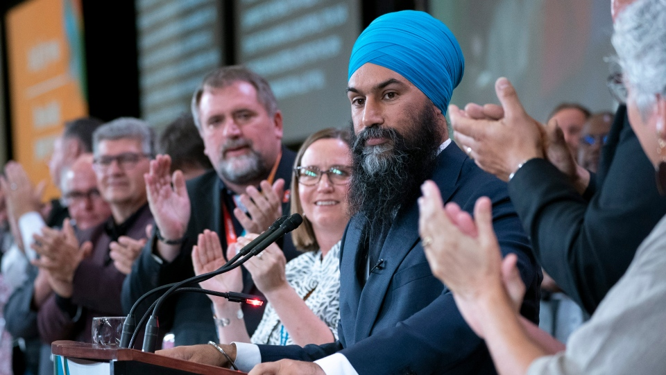 NDP Leader Jagmeet Singh is applauded during a speech at the Canadian Union of Public Employees convention in Montreal, on Wednesday, October 9, 2019. THE CANADIAN PRESS/Paul Chiasson