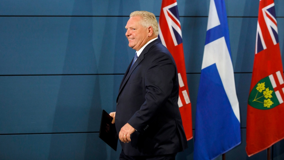 Ontario Premier Doug Ford leaves a press conference at the Toronto Police College in Toronto, Friday, Aug. 23, 2019. THE CANADIAN PRESS/Cole Burston