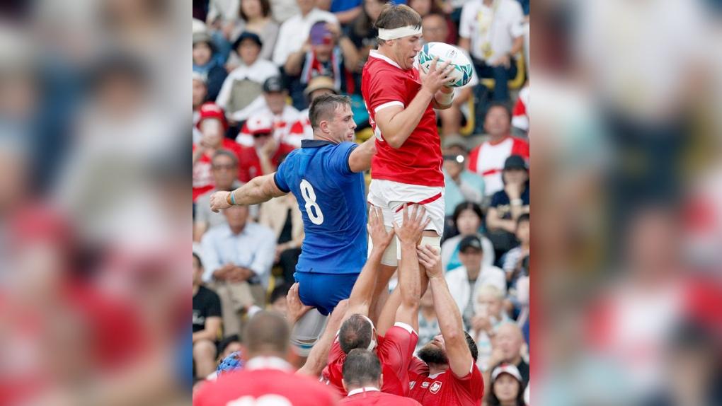 Canada's Josh Larsen, right, is held aloft